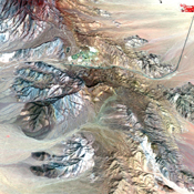 This image of the Mountain Pass rare open-pit earth mine was acquired by NASA's Terra spacecraft in southeastern California near the Nevada border.