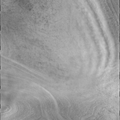 Polar surface winds can reach high velocities. These winds can cause clouds to form when the winds flow into troughs and become chaotic. This image from NASA's Mars Odyssey shows trough clouds as linear bands.