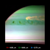 This false-color infrared image, obtained by NASA's Cassini spacecraft, shows clouds of large ammonia ice particles dredged up by a powerful storm in Saturn's northern hemisphere.