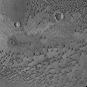 The dunes in this image from NASA's Mars Odyssey are located on the floor of an unnamed crater in Terra Cimmeria.