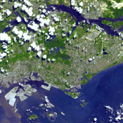 This image from NASA's Terra spacecraft is of the Republic of Singapore, a city-state off the southern tip of the Malay Peninsula. An island country made up of 63 islands, the country is largely urbanized with very little rain forest left.