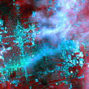 On May 30, 2011, a week after an EF-5 tornado swept through the city of Joplin, Mo, NASA's Terra spacecraft captured this image showing the track of the deadly tornado through the city (shown horizontally in green-blue).