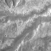 This image from NASA's 2001 Mars Odyssey shows a few of the many channels named (in this case Arda Valles) and unnamed that empty into a large low in Margaritifer Terra.