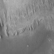 Wind has eroded the deposit on the floor of Gale Crater in this image captured by NASA's 2001 Mars Odyssey.