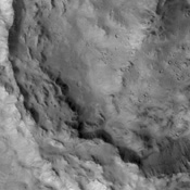 The pristine nature of this crater and its ejecta indicate that it is younger than the outflow channel where it is located. This image is from NASA's 2001 Mars Odyssey.