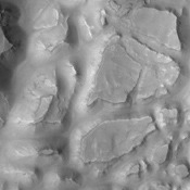 This image from NASA's 2001 Mars Odyssey spacecraft shows part of the mesa and valley terrain called 'chaos.' This region of chaos is near the far eastern end of Valles Marineris.