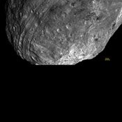 This image, obtained by the framing camera on NASA's Dawn spacecraft, a peak at Vesta's south pole is seen at the lower right. The grooves in the equatorial region are about six miles wide.