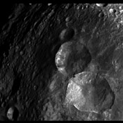 In this image, obtained by the framing camera on NASA's Dawn spacecraft, a set of three craters, informally nicknamed 'Snowman' by the camera's team members, is located in the northern hemisphere of Vesta.