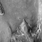 The layered ridge and mesas in this image from NASA's 2001 Mars Odyssey spacecraft are located on the northern margin of Hellas Basin.