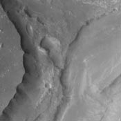 Aurorae Chaos is located at the eastern end of the chasmata forming Vallis Marineris. This image from NASA's 2001 Mars Odyssey spacecraft is very close to the chasmata and at a higher elevation than the floor of the chasmata.