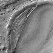 This image from NASA's Mars Reconnaissance Orbiter shows some of the weirdest and least-understood landscapes on Mars are on the floor of the deep Hellas impact basin.