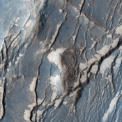 NASA's Mars Reconnaissance Orbiter captured this image of the Claritas Fossae region, characterized by systems of