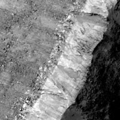 This image comes from observations of steep crater slopes on Terra Cimmeria by the HiRISE camera onboard NASA's Mars Reconnaissance Orbiter.