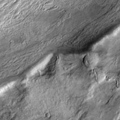 This image from NASA's 2001 Mars Odyssey spacecraft shows several large channels emptying into the eastern Hellas Basin. These southern channels are filled with material today. Whether the material contains volitiles (like ice) is unknown.