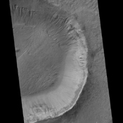 This image contrasts gullies and recurring warm-season slope flows appearing in the same crater, in the middle southern latitudes of Mars. It was taken Nov. 27, 2007, by the HiRISE camera onboard NASA's Mars Reconnaissance Orbiter.