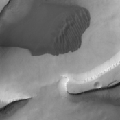 The dunes in this image captured by NASA's 2001 Mars Odyssey spacecraft sare located in the depressions of Sisyphi Cavi.