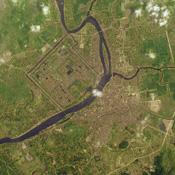 This image from NASA's Terra satellite is of Hue, Vietnam. The Perfume River flows through the Capital City, the Imperial City, the Forbidden Purple City and the inner city.