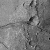 Fractures mark the surface in this region of Margaritifer Terra in this image captured by NASA's 2001 Mars Odyssey spacecraft.