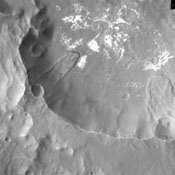 This image from NASA's 2001 Mars Odyssey spacecraft shows two landslide deposits located on the southern side of Columbus Crater in Terra Sirenum.