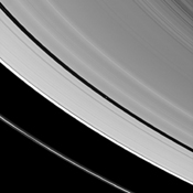 Saturn's tiny moon Pan orbits in the middle of the Encke Gap of the planet's A ring in this image from the Cassini spacecraft. Pan is visible as a bright dot in the gap near the center of this view.