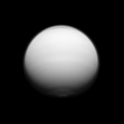Titan shows us its active polar atmosphere with the north polar hood and south polar vortex both on display in this image captured by NASA's Cassini spacecraft.