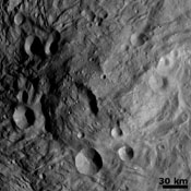 NASA's Dawn spacecraft obtained this image of a central mound in a large structure at the south pole of asteroid Vesta with its framing camera on August 12, 2011. This image was taken through the camera's clear filter.