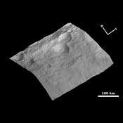 This view of the topography of asteroid Vesta's surface is composed of several images obtained with the framing camera on NASA's Dawn spacecraft on August 6, 2011. The image mosaic is shown superimposed on a digital terrain model.