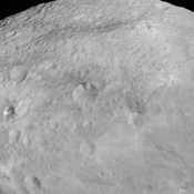 NASA's Dawn spacecraft obtained this image of dark patches and stripes on crater walls on asteroid Vesta with its framing camera on August 18, 2011. The image has a resolution of about 260 meters per pixel.