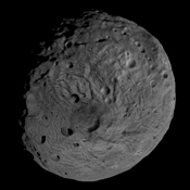 This image obtained by the framing camera on NASA's Dawn spacecraft shows the south pole of the giant asteroid Vesta. Scientists are discussing whether the circular structure that covers most of this image originated by a collision with another asteroid.