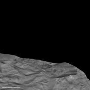 The south pole of the giant asteroid Vesta reveals cliffs that are several miles or kilometers high, deep grooves, and craters. This oblique view is from NASA's Dawn spacecraft.