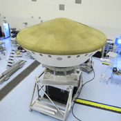At the Payload Hazardous Servicing Facility at NASA's Kennedy Space Center in Florida, the Mars Science Laboratory rover, Curiosity, and the spacecraft's descent stage have been enclosed inside the spacecraft's aeroshell.