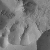NASA's 2001 Mars Odyssey spacecraft captured this image of the southwestern margin of Juventae Chasma. Located to the north of Marineris Vallis, this chasma is elongate in the north-south direction, rather than east-west.
