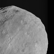 This image from NASA's Dawn spacecraft shows dark colored mountains (top of the image) in the northern region of asteroid Vesta. The origin of such mountains is currently being investigated.