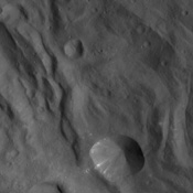 In this image of the asteroid Vesta, taken by NASA's Dawn spacecraft just shortly before the beginning of high altitude mapping orbit, north is up and the upper right corner is to the northeast.