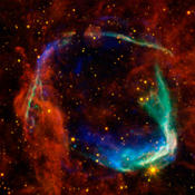 This image combines data from four different space telescopes to create a multi-wavelength view of all that remains of the oldest documented example of a supernova, called RCW 86.