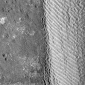 The eastern margin of a rippled dune in Herschel Crater on Mars moved an average distance of three meters (about three yards) between March 3, 2007 and December 1, 2010, in one of two images taken by NASA's Mars Reconnaissance Orbiter.