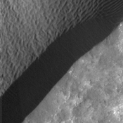 A rippled dune front in Herschel Crater on Mars moved an average of about one meter (about one yard) between March 3, 2007 and December 1, 2010, as seen in one of two images from NASA's Mars Reconnaissance Orbiter.