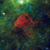 Seen as a red dusty cloud in this image from NASA's Wide-field Infrared Survey Explorer, Puppis A is the remnant of a supernova explosion.