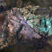 The colorful rocks exposed in the central peak visible in this image from NASA's Mars Reconnaissance Orbiter probably reflect variations in mineral content that were caused by water activity early in Mars' history.