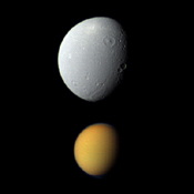 Saturn's largest moon, Titan, appears deceptively small paired here with Dione, Saturn's fourth-largest moon, in this view from NASA's Cassini spacecraft.