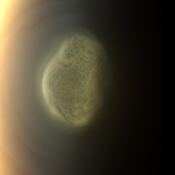 This true color image captured by NASA'S Cassini spacecraft before a distant flyby of Saturn's moon Titan on June 27, 2012, shows a south polar vortex, or a mass of fluid-like clouds and haze swirling around the pole in the atmosphere of the moon.