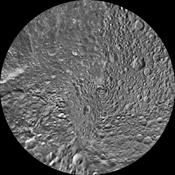 The northern and southern hemispheres of Saturn's moon Mimas are seen in these polar stereographic maps, mosaicked from the best-available NASA's Cassini and Voyager images.