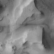 This image from NASA's 2001 Mars Odyssey shows the mesas and mountain tops of Capri Chasma.