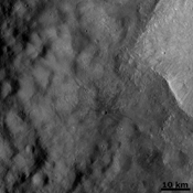 The crater on asteroid Vesta shown in this image from NASA's Dawn spacecraft was emplaced onto the ejecta blanket of two large twin craters. Commonly, rays from impact craters are brighter than the surrounding surface.