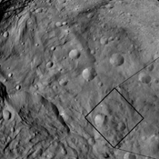This image from NASA's Dawn spacecraft shows craters with both sharp and smooth crater rims in asteroid Vesta's southern hemisphere. Detailed structure is seen more readily in the the image with a smaller view at right.
