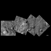 This image from NASA's Dawn spacecraft shows craters with both sharp and smooth rims, a 'ghost' crater and dark and bright material in asteroid Vesta's southern hemisphere.