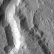 This image captured by NASA's 2001 Mars Odyssey spacecraft is of an unnamed channel located on the northern margin of Terra Cimmeria.