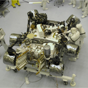 The Mars Science Laboratory mission's rover, Curiosity, is prepared for final integration into the complete NASA spacecraft in this photograph taken inside the Payload Hazardous Servicing Facility at NASA Kennedy Space Center, Fla.