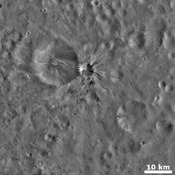 This image from NASA's Dawn spacecraft shows a small, young, fresh crater on asteroid Vesta with bright and dark rays extending from it.