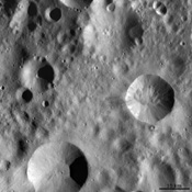 This image from NASA's Dawn spacecraft shows four large impact craters close to one another on Vesta's surface. Interestingly, each of these four has a distinct preservation state.